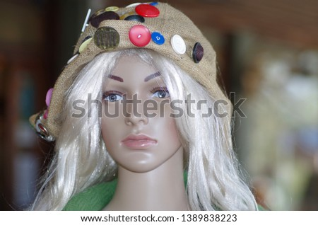 Beautiful as a doll. Blond mannequin with nice homemade hat. #1389838223