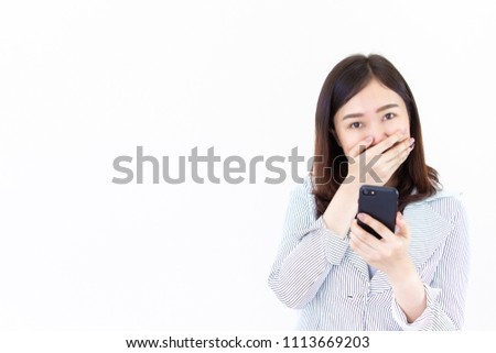 Beautiful Asian business women age between 25-30 years old in the white suit  looking at her smartphone and laughing close up.  Drop white copy on the left side for text or other use.