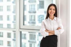 Beautiful Asian businesswoman near window in office