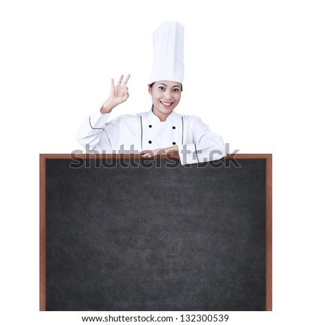 Beautiful Asian chef with copy space, isolated on white