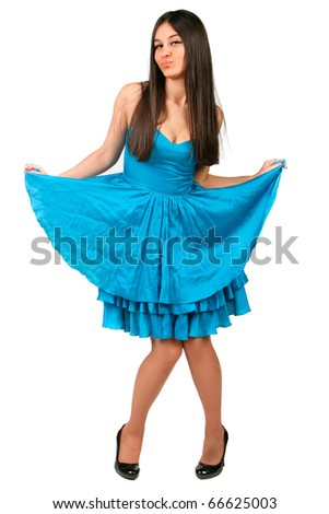 Beautiful Asian girl in a blue dress plays the fool on a white background