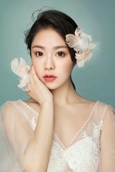 Beautiful Asian girl in green background