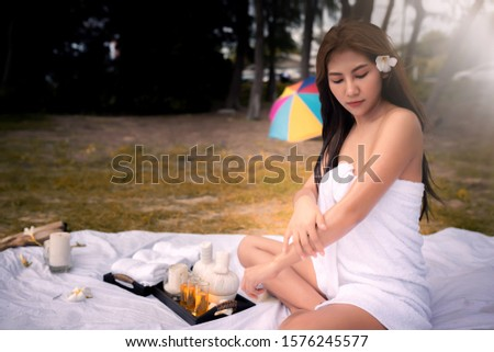 Beautiful Asian girl relaxing holiday With a spa outdoor, Aromatherapy , Relax concept.