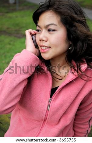 Beautiful asian girl talking on a phone