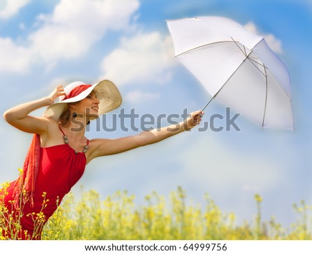 Beautiful asian girl under blue sky with umbrella in field.