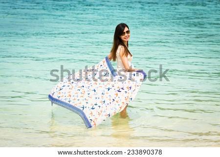 Beautiful Asian girl wading in the sea, Lipe island, Andaman sea, Thailand.