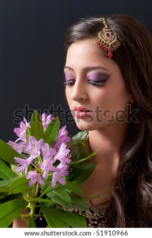 Beautiful asian girl with bridal makeup, isolated on black