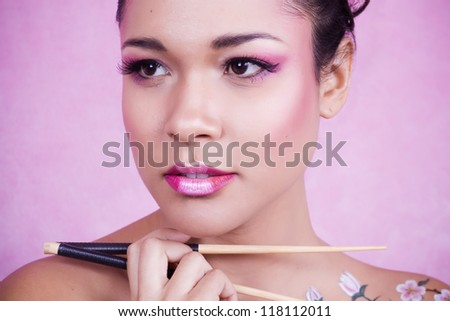 beautiful asian girl with chopsticks to eat food