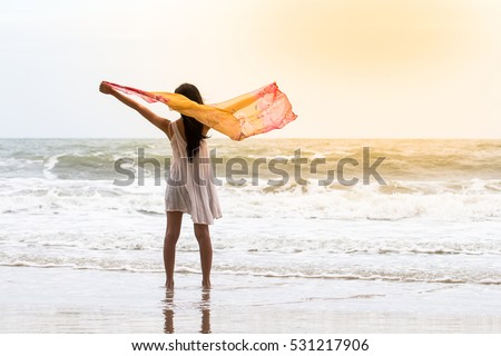 Beautiful asian Girl With Scarf on The Beach,woman freedom concept enjoying nature on free day
