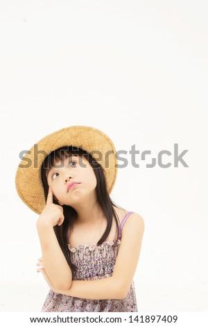 Beautiful asian little girl thinking