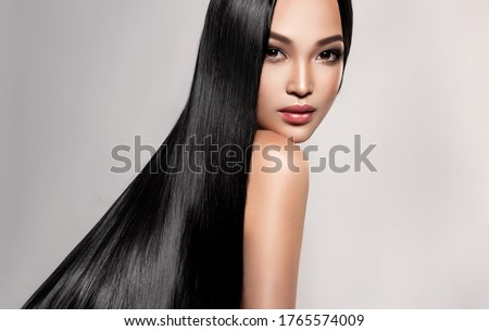 Beautiful asian model girl with shiny black and straight long hair . Keratin straightening . Treatment, care and spa procedures for hair . Chinese girl with smooth hairstyle Stock fotó ©