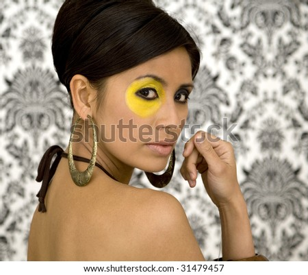 asian model makeup. stock photo : Beautiful Asian model with strong make-up and retro wallpaper