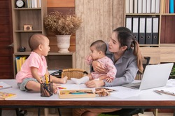 Beautiful Asian mother confuse multi task work at home, single mom blame kids fighting, women work from home fussy taking care chaotic children in quarantine social distance during Covid-19 crisis,