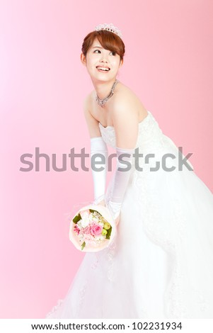 Beautiful asian woman dressed as a bride - stock photo
