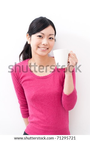 beautiful asian woman drinking - stock photo