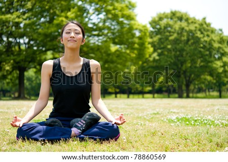 beautiful asian woman exercising in the park