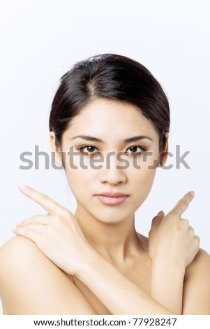Beautiful Asian woman framing her face with hands.