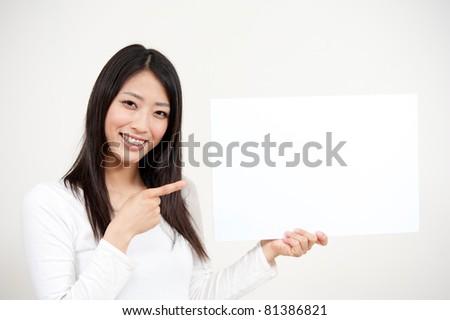 beautiful asian woman holding a blank whiteboard