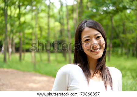 beautiful asian woman in the forest - stock photo