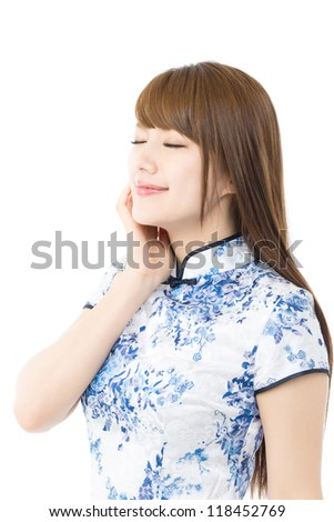 Beautiful asian woman in traditional chinese clothing on white background - stock photo
