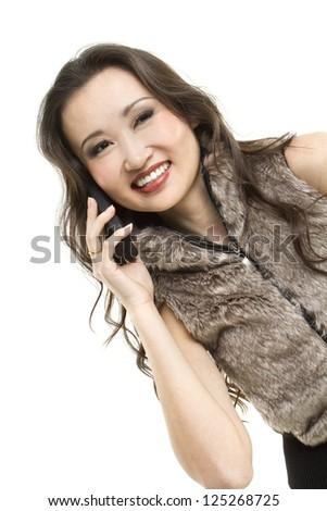 Beautiful Asian woman on mobile phone. - stock photo