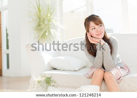 Beautiful asian woman relaxing in the room