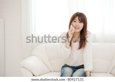 beautiful asian woman relaxing on the couch