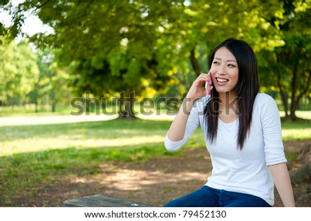 beautiful asian woman sitting on the park bench