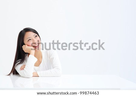 beautiful asian woman thinking