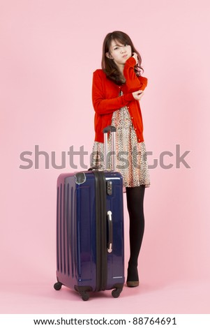 Beautiful asian woman traveling with bag