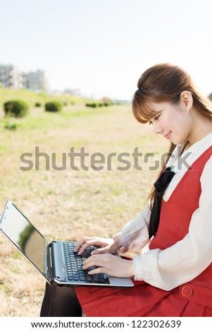 Beautiful asian woman using a laptop computer