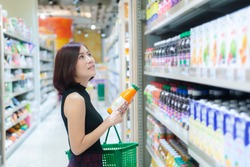Beautiful asian woman walking shopping in a supermarket,Time for relax,Buy for dinner,Thailand people,Happy time lifestyle concept