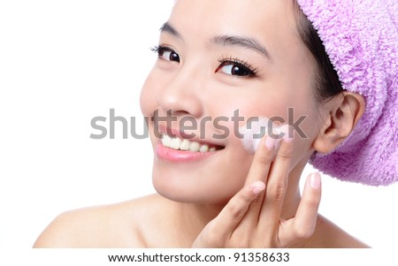 Beautiful asian woman washing her beauty face with cleansing foam on her hands, isolated on white background
