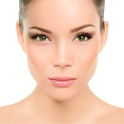 Beautiful asian woman with green eyes and perfect beauty makeup. Mixed race chinese caucasian young girl with green eyes cosmetic concept. Perfect features and skin.