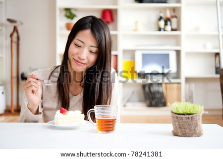 beautiful asian woman with tea and cake