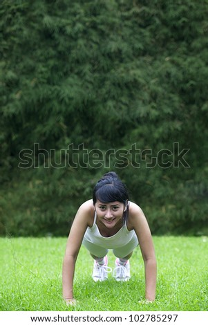 Beautiful asian woman working out outdoor. Shot in summer