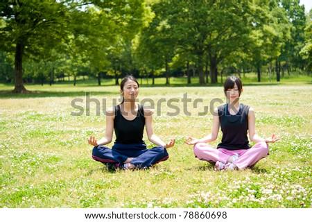 beautiful asian women exercising in the park