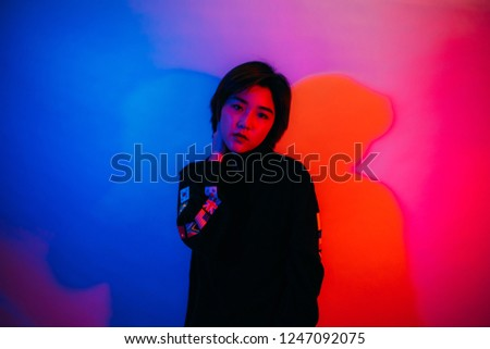 Beautiful Asian women in costumes and costumes look stylish with red and blue neon light.