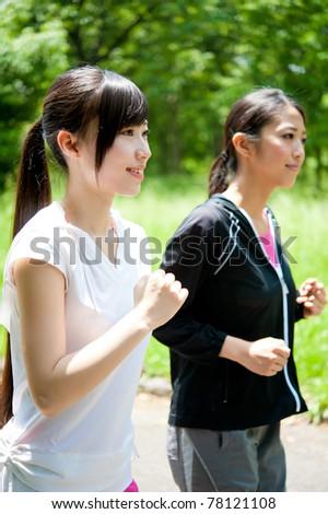 beautiful asian women jogging in the park