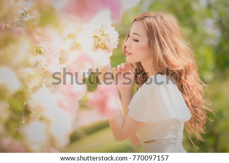 Beautiful asian young bride outdoors in a forest. Pretty Thai girl in garden.