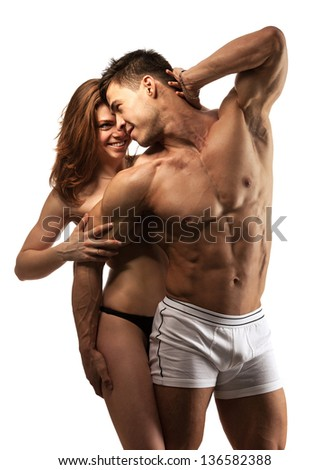 Beautiful athletic couple over white