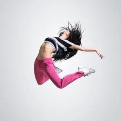 beautiful athletic girl dancing jumping