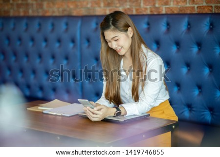 Beautiful Attractive Asian business woman using smartphone for shopping online and using social media in coffee shop cafe smile and happiness #1419746855