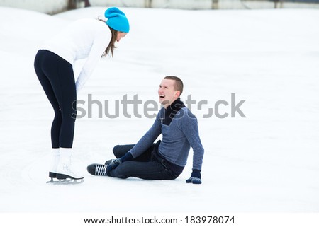 Beautiful, attractive couple on the ice rink #183978074