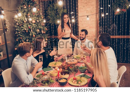 Beautiful attractive stylish classy elegant cheerful people sitting at dinner table with martini, slim gorgeous girl saying toast, house festive #1185197905
