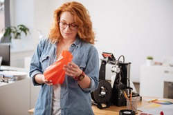 Beautiful attractive woman holding a 3d printed vase