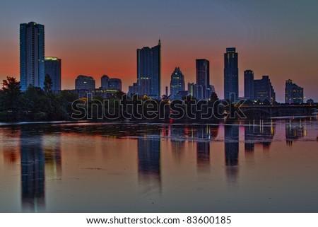 Beautiful Austin skyline reflection on Lady Bird Lake before sunrise