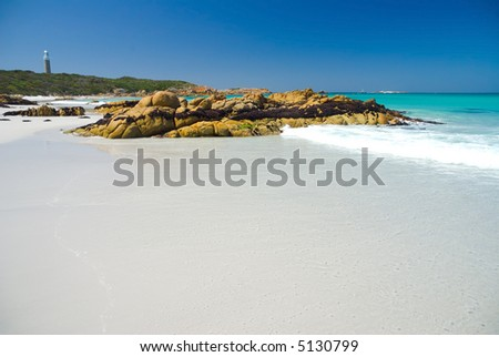 Beautiful Australian beach with rocks and lighthouse, Bay of Fires, Tasmania