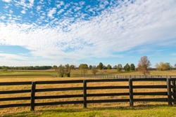 Beautiful autumn country landscape with pastures of horse farms.