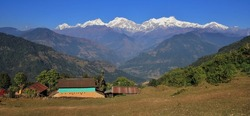 Beautiful autumn day in the Annapurna Conservation Area, Nepal. Rural landscape and snow capped Manaslu range.